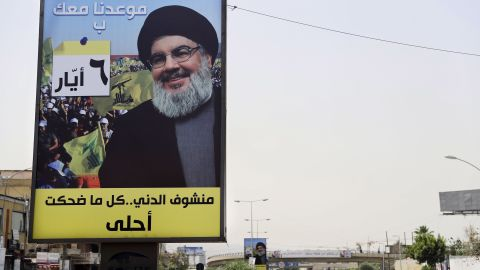 A portrait of Hassan Nasrallah, leader of the Hezbollah movement, is fixed on the side of a road in the mainly Shia southern suburbs of Beirut.