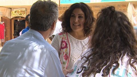 Civil society candidate Rania Masri distributes fliers in the Lebanese mountain area of Metn.