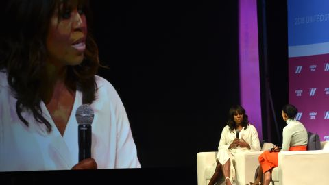 Former first lady Michelle Obama (L) and actress/activist Tracee Lee Ross attend the United State of Women Summit at the Shrine Auditorium in Los Angeles, on May 5, 2018.