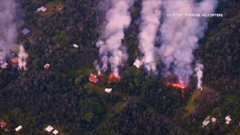 Aerial footage shows lava spilling from a fissure.