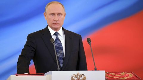 Russian president-elect Vladimir Putin takes the oath of office during a ceremony at the Kremlin in Moscow on May 7, 2018. (Photo by Alexander ASTAFYEV / SPUTNIK / AFP)        (Photo credit should read ALEXANDER ASTAFYEV/AFP/Getty Images)