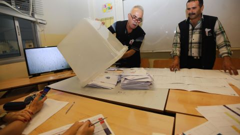 Lebanese officials count votes at a polling center in Beirut after polling stations closed for Lebanon's first parliamentary elections in nine years on May 6, 2018.