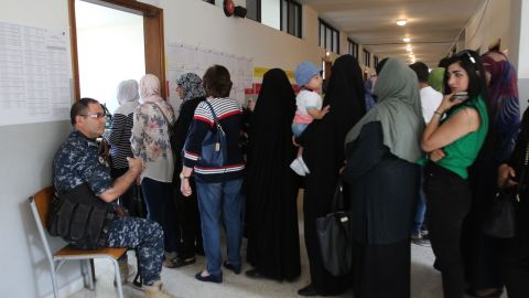 Lebanese women wait to vote at a polling station in the city of Nabatieh in southern Lebanon on May 6, 2018.