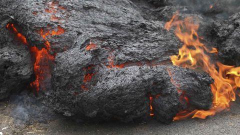 Lava burns across a road Saturday in the Leilani Estates community on Hawaii's Big Island.