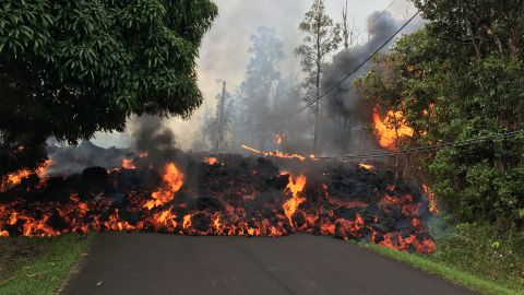 A lava flow moves down Makamae Street in Leilani Estates Sunday.