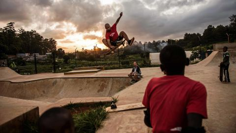 Youths skateboard at Shangilia skatepark in Nairobi on January 13, 2016.  The skate park was built in 2013 by the NGO Skate-Aid, and more than a hundred children from the surrounding area attend the skatepark every week. There is a limited amount of pads, helmets and skateboards at the park so the kids have to share.   / AFP / FREDRIK LERNERYD        (Photo credit should read FREDRIK LERNERYD/AFP/Getty Images)