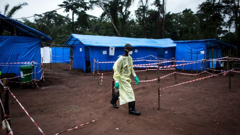 TOPSHOT - A health worker walks at an Ebola quarantine unit on June 13, 2017 in Muma, after a case of Ebola was confirmed in the village. Two cases of the Ebola virus have been confirmed in a laboratory while 18 others are suspected in the remote Bas-Uele province, an equatorial forest zone near the Central African Republic. It is the first outbreak of Ebola, which spreads by contact with bodily fluids, since the west Africa epidemic that ended in January last year after killing more than 11,300 people and sickening nearly 29,000. / AFP PHOTO / JOHN WESSELS        (Photo credit should read JOHN WESSELS/AFP/Getty Images)
