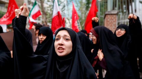 Iranian women chant slogans during an anti-US demonstration outside the former US embassy headquarters in the capital Tehran on May 9, 2018. - Iranians reacted with a mix of sadness, resignation and defiance on May 9 to US President Donald Trump's withdrawal from the nuclear deal, with sharp divisions among officials on how best to respond. For many, Trump's decision on Tuesday to pull out of the landmark nuclear deal marked the final death knell for the hope created when it was signed in 2015 that Iran might finally escape decades of isolation and US hostility. (Photo by ATTA KENARE / AFP)        (Photo credit should read ATTA KENARE/AFP/Getty Images)