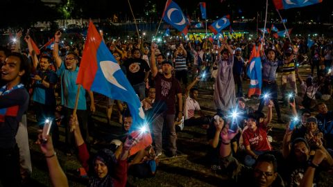 Supporters of Mahathir Mohamad, cheer as they watch live televised result announcement of the 14th general elections on May 10, 2018 in Kuala Lumpur, Malaysia.