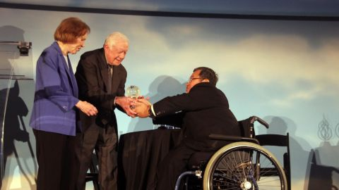 Former President Jimmy Carter and First Lady Rosalynn Carter accepted an award for global public health on Wednesday.