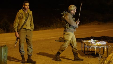 An Israeli soldiers stands on a closed road in the Golan Heights early Thursday.