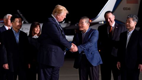 US President Donald Trump (centre L) shakes hands with US detainee Kim Dong-chul (3rd R) upon his return with fellow detainees Kim Hak-song (R) and Tony Kim (front L) after they were freed by North Korea, at Joint Base Andrews in Maryland on May 10, 2018. - US President Donald Trump greeted the three US citizens released by North Korea at the air base near Washington early on May 10, underscoring a much needed diplomatic win and a stepping stone to a historic summit with Kim Jong Un. (Photo by SAUL LOEB / AFP)        (Photo credit should read SAUL LOEB/AFP/Getty Images)