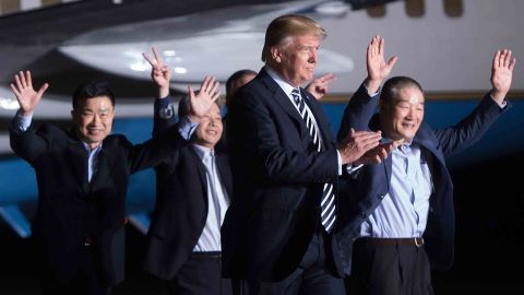 US President Donald Trump walks with the former US detainees on May 10, 2018, after their arrival at Joint Base Andrews in Maryland.