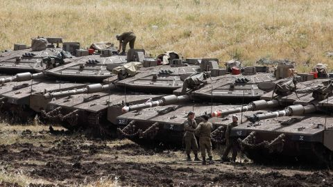 Israeli Merkava tanks are seen in a deployment area near the Syrian border in the Golan Heights on May 10, 2018.  (Photo credit should read MENAHEM KAHANA/AFP/Getty Images)