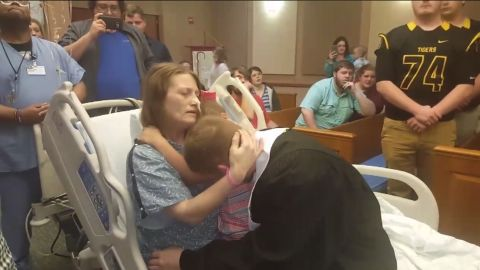 Stephanie Northcott hugs her son Dalton and her granddaughter Maddyson from her hospital bed after Dalton graduated high school on May 4th.