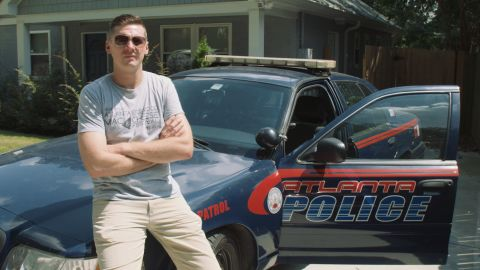 Officer Mike Costello outside his home in Edgewood