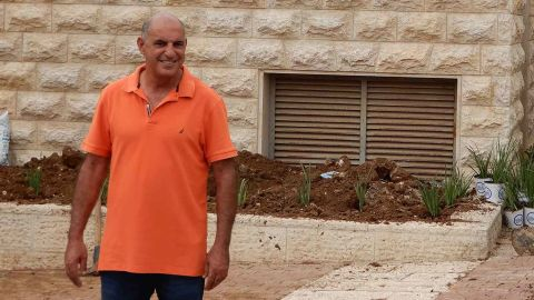 Shimon Aviv, a 45-year-old gardener planting new flowers for the ceremony on Monday.