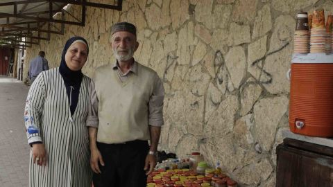 Abu Mohammad Al-Mashni and his wife, Um Mohammad Al-Mashni, both selling spices and coffee at Bethlehem checkpoint.