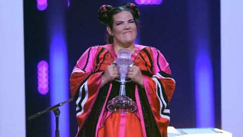 Israel's Netta Barzilai holds a trophy after winning the Eurovision Song Contest 2018 in Lisbon.
