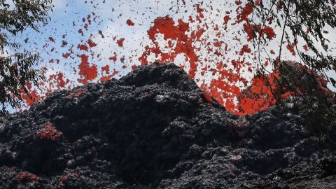 PAHOA, HI - MAY 12:  A lava fissure erupts in the aftermath of eruptions from the Kilauea volcano on Hawaii's Big Island, on May 12, 2018 in Pahoa, Hawaii. The U.S. Geological Survey said a recent lowering of the lava lake at the volcano's Halemaumau crater Òhas raised the potential for explosive eruptionsÓ at the volcano. Authorities have confirmed the fissure is the 16th to open.  (Photo by Mario Tama/Getty Images)