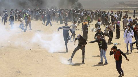 Palestinian protesters near the Israeli border fence on Monday.