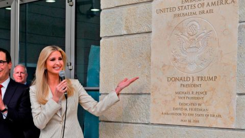 US Treasury Secretary Steve Mnuchin (C-L) claps as US President's daughter Ivanka Trump unveils an inauguration plaque during the opening of the US embassy in Jerusalem on May 14, 2018. - The United States moved its embassy in Israel to Jerusalem after months of global outcry, Palestinian anger and exuberant praise from Israelis over President Donald Trump's decision tossing aside decades of precedent. (Photo by Menahem KAHANA / AFP)        (Photo credit should read MENAHEM KAHANA/AFP/Getty Images)