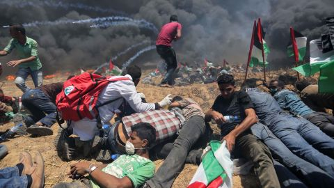 Palestinians set tires on fire during a protest on Monday.