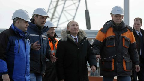Russian President Vladimir Putin (C) inspects the road section of the road-and-rail Crimean Bridge over the Kerch Strait on March 14, 2018. / AFP PHOTO / POOL / YURI KOCHETKOV        (Photo credit should read YURI KOCHETKOV/AFP/Getty Images)