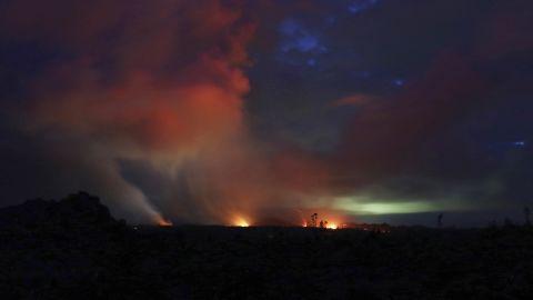 Lava shoots into the night sky from active fissures on the lower east rift of Kilauea volcano, Tuesday, May 15, 2018 near Pahoa, Hawaii. (AP Photo/Caleb Jones)