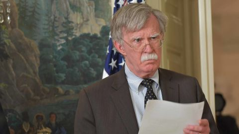 National Security Advisor John Bolton listens as US President Donald Trump addresses the nation on the situation in Syria April 13, 2018 at the White House in Washington, DC. Trump said strikes on Syria are under way.  / AFP PHOTO / Mandel NGAN        (Photo credit should read MANDEL NGAN/AFP/Getty Images)