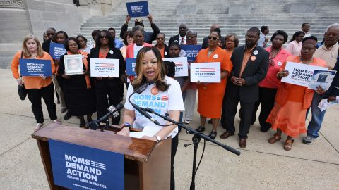 Lucy McBath, National Spokeswoman for Moms Demand Action for Gun Sense in America, is joined by faith leaders, gun violence survivors and others on the south steps of the Mississippi State Capitol in Jackson, Ms., on Thursday, March 17, 2016, to protest House Bill 786, also know as the Mississippi Church Protection Act, that would allow people to carry concealed handguns in public with no permit, (Joe Ellis/The Clarion-Ledger via AP)