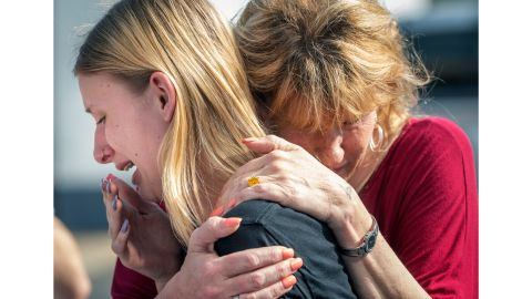 Santa Fe High School student Dakota Shrader is comforted by her mother Susan Davidson following a shooting at the school on Friday, May 18, 2018, in Santa Fe, Texas. Shrader said her friend was shot in the incident.  (Stuart Villanueva/The Galveston County Daily News via AP)