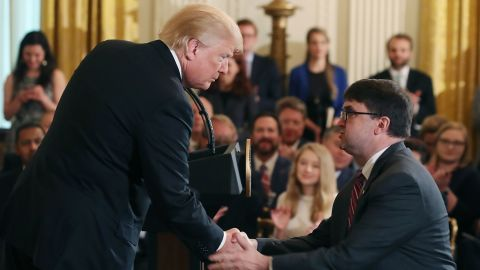WASHINGTON, DC - MAY 18: U.S. President Donald Trump shakes hands with Robert Wilkie after nominating him to be next Veterans Affairs Secretary, during an event in the East Room at the White House, on May 18, 2018 in Washington, DC. President Trump spoke briefly at the Prison Reform Summit.  (Photo by Mark Wilson/Getty Images)