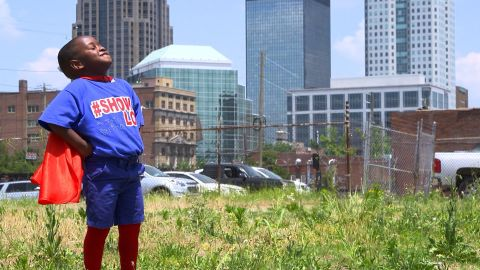 Austin Perine, age 4, dresses up as a superhero to feed the homeless men outside a shelter in Birmingham, Alabama.