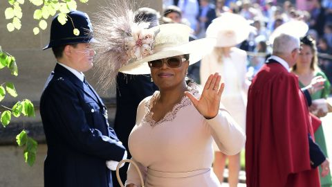 Oprah Winfrey waves as she arrives at St George's Chapel at Windsor Castle the wedding ceremony of Prince Harry and Meghan Markle at St. George's Chapel in Windsor Castle in Windsor, near London, England, on Saturday. (Ian West/pool photo via AP)