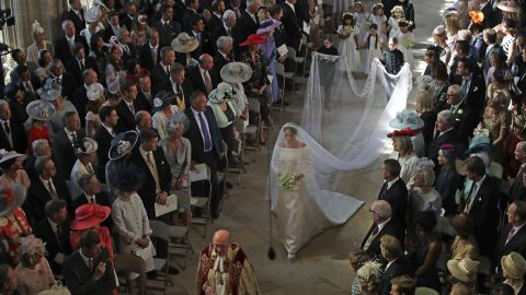 US actress Meghan Markle (C) walks down the aisle in St George's Chapel, Windsor Castle, in Windsor, on May 19, 2018 during her wedding to Britain's Prince Harry, Duke of Sussex. (Photo by Danny Lawson / POOL / AFP)        (Photo credit should read DANNY LAWSON/AFP/Getty Images)
