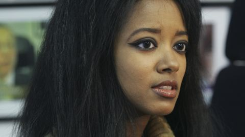 FILE - In this Sept. 22, 2006, file photo, former Playboy playmate Stephanie Adams speaks at an interview in New York about her lawsuit against the New York City Police Department.  Law enforcement officials say Adams, who was involved in a custody battle, apparently jumped with her 7-year-old son Vincent from the penthouse at the Gotham Hotel in midtown Manhattan. They were found on a second-floor balcony by workers at about 8:15 a.m. Friday, May 18, 2018. (AP Photo/Tina Fineberg, File)
