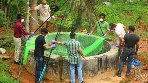 Officials in Kerala inspect a well to catch bats that can carry the Nipah virus.
