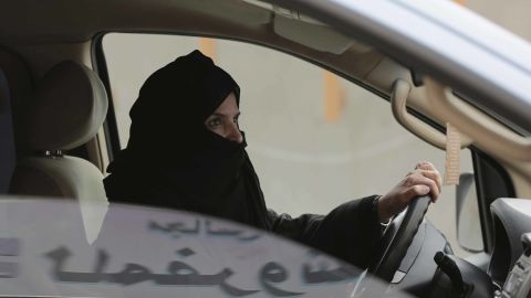 In a 2014 file photo, Aziza al-Yousef drives a car in Riyadh as part of a campaign to defy the driving ban.
