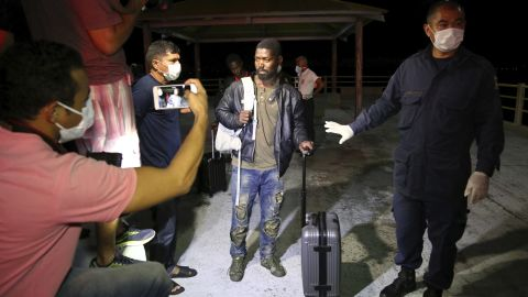 In this photo released by Maranhao state, an unidentified African migrant arrives after he was rescued by fishermen, at the pier of Sao Jose de Ribamar, Brazil, Sunday, May 20, 2018.
