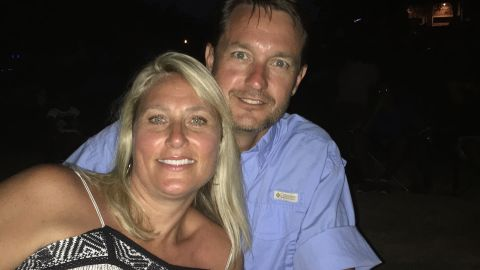 Julie Mignerey, seen here with her husband, had a hard time keeping up with her family after turning 40.