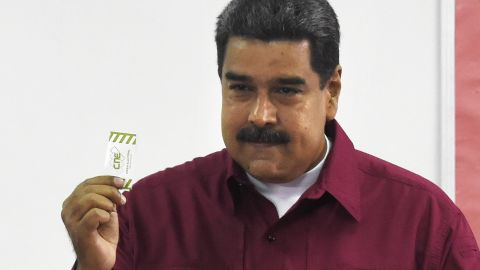 Venezuelan President Nicolas Maduro casts his vote during the presidential elections in Caracas on May 20, 2018.