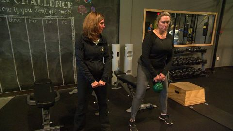 Mignerey learns how to properly lift a kettlebell in this low-impact functional fitness class.