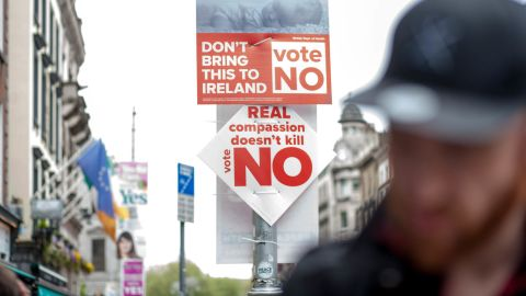 Signs from the No campaign are seen on a Dublin street.