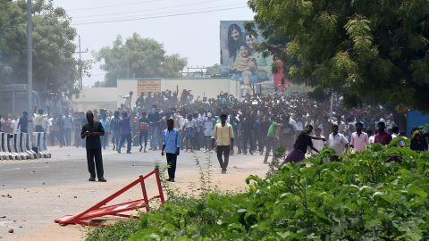 Indian protesters throw stones at police in the southern Indian city of Tuticorin.