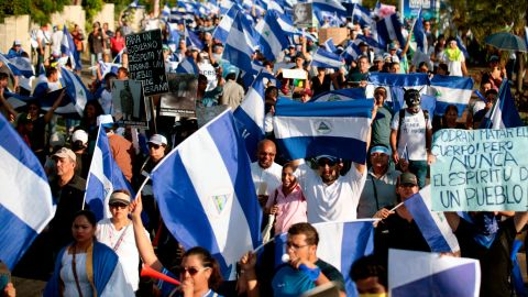 """People take part in a march marking a month since the beginning of protests against the government in Managua on May 18, 2018. - The Inter-American Commission on Human Rights on Friday called for Nicaragua's government to """"immediately halt the repression of protests"""" against President Daniel Ortega, as the death toll rose to 63. (Photo by DIANA ULLOA / AFP)        (Photo credit should read DIANA ULLOA/AFP/Getty Images)"""