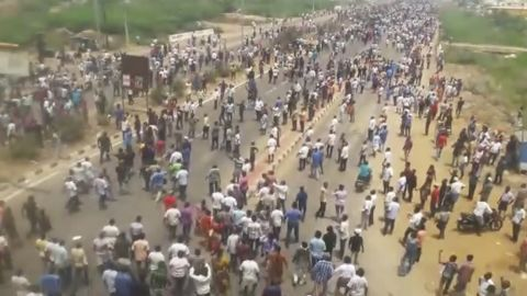 This frame grab from video provided by KK Productions shows protesters crowding a road in Tuticorin, in the southern Indian state of Tamil Nadu, on Tuesday. Eleven people have died in two days of clashes with police there as demonstrators demand the closure of a Sterlite copper-smelting plant.