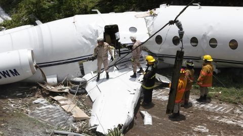 An emergency crew works Tuesday at the site where a private jet crashed near Tegucigalpa, Honduras.
