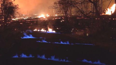 The blue flames are produced by burning methane.
