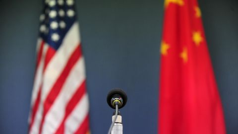 The US and China flags stand behind a microphone awaiting the arrival of US Senator John McCain, who was joined by Senators Lindsey Graham Amy Klobuchar for a press conference at the US Embassy in Beijing on April 9, 2009 during the China stop of the Congressional Delegation's fact-finding Asia-tour. Senator McCain said he urged Chinese officials in talks here to back a strong United Nations response to North Korea's rocket launch, but indicated China had resisted. AFP PHOTO/Frederic J. BROWN (Photo credit should read FREDERIC J. BROWN/AFP/Getty Images)